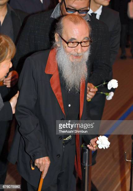 Actor Mickey Curtis offers a flower at an altar at the farewell meeting for late musician Hiroshi Kamayatsu on May 2, 2017 in Tokyo, Japan.