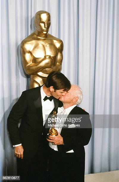 Actor Mickey Rooney gives his son Tim Rooney a kiss backstage after receiving Honorary Academy Award during the 55th Academy Awards at Dorothy...