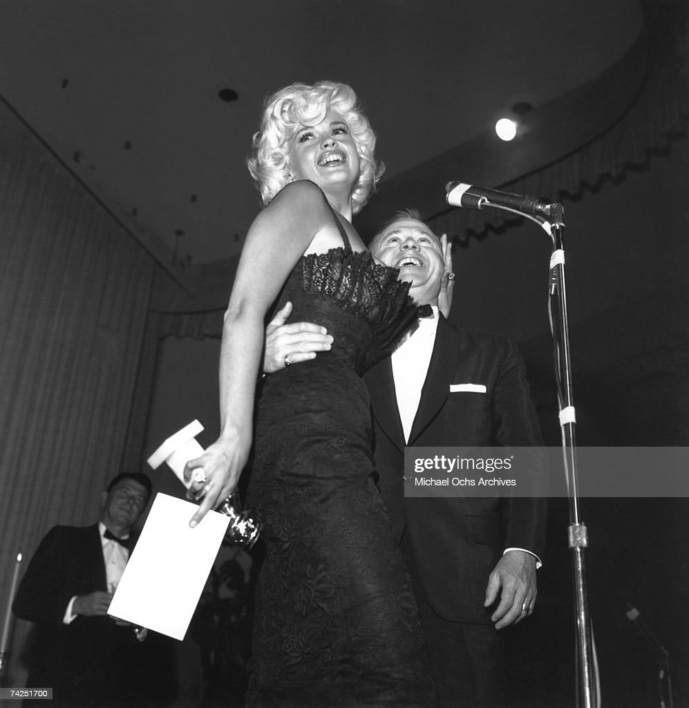 Actor Mickey Rooney hugs actress Jayne Mansfield as he accepts an ...