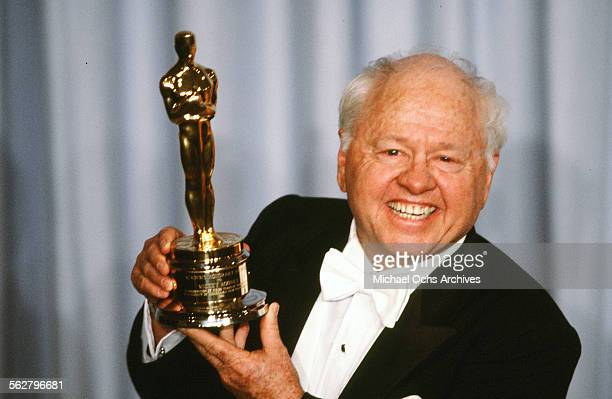 Actor Mickey Rooney poses backstage after receiving Honorary Academy Award during the 55th Academy Awards at Dorothy Chandler Pavilion Los Angeles...