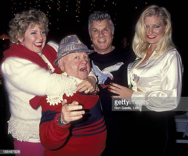 Actor Mickey Rooney wife Jan Rooney actor Tony Curtis and Jill Vanderberg attend 63rd Annual Hollywood Christmas Parade on November 27 1994 at KTLA...
