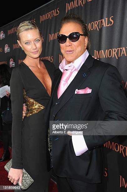 Actor Mickey Rourke and Anastassija Makarenko arrive at Relativity Media's Immortals premiere presented in RealD 3 at Nokia Theatre LA Live on...
