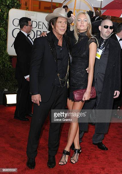 Actor Mickey Rourke and guest arrive at the 67th Annual Golden Globe Awards at The Beverly Hilton Hotel on January 17 2010 in Beverly Hills California