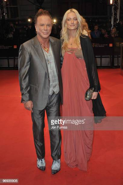 Actor Mickey Rourke and guest attend the Orange British Academy Film Awards 2010 at the Royal Opera House on February 21 2010 in London England
