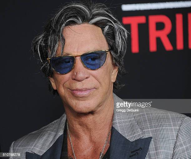 Actor Mickey Rourke arrives at the premiere of Open Road's Triple 9 at Regal Cinemas LA Live on February 16 2016 in Los Angeles California