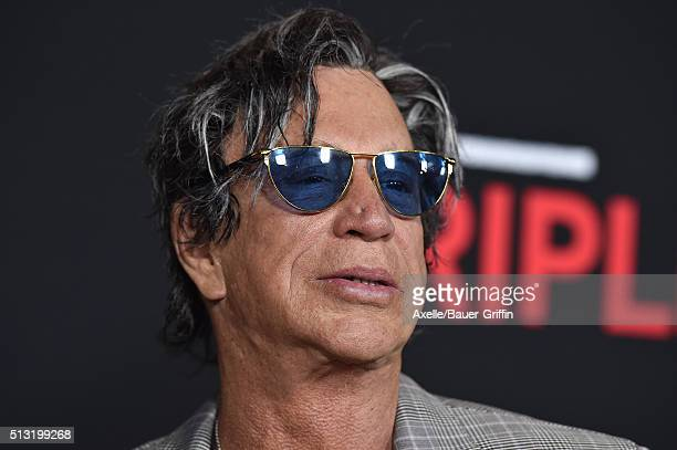 Actor Mickey Rourke arrives at the premiere of Open Road's 'Triple 9' at Regal Cinemas LA Live on February 16 2016 in Los Angeles California