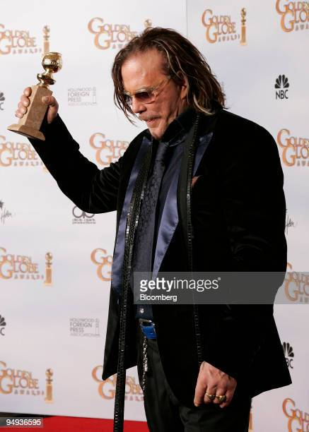 Actor Mickey Rourke holds his award for Best Performance by an Actor in a Motion Picture for 'The Wrestler' backstage at the 66th Annual Golden...