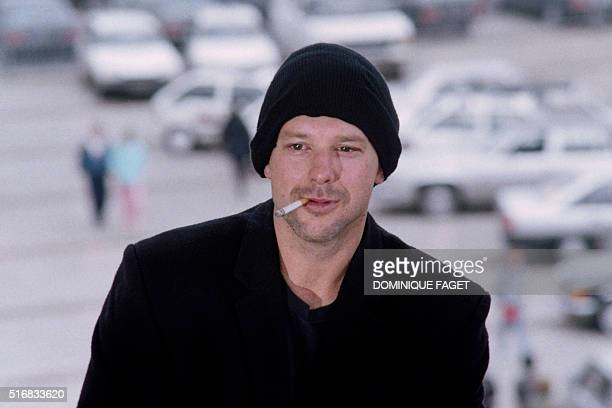 US actor Mickey Rourke poses on May 18 1987 in a Cannes festival palace terrace after the screening of the film 'Barfly' directed by Barbet Schroeder...