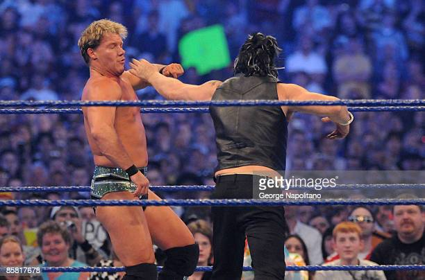 Actor Mickey Rourke punches Chris Jericho during WrestleMania 25 at the Reliant Stadium on April 5 2009 in Houston Texas