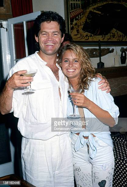 Actor Micky Dolenz and his daughter Ami Dolenz lift a glass in good spirits as they pose in 1987 in Los Angeles California