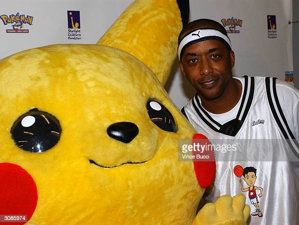 Actor Miguel Nunez poses with Pikachu at the Frankie Muniz HoopLA celebrity charity basketball game presented by Pokemon Trading Card Games on March...