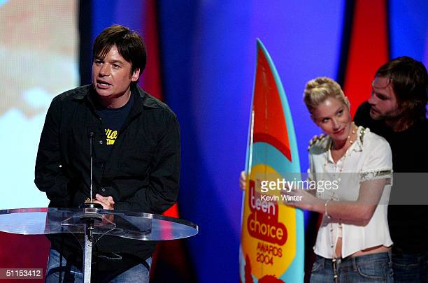 Actor Mike Meyers accepts the Choice Movie Comedy on behalf of 'Shrek 2' from presenters Christina Applegate and Seann William Scott on stage at The...
