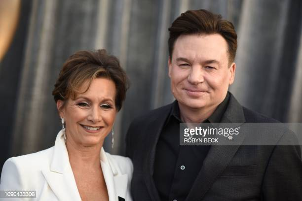 Actor Mike Myers and SAGAFTRA President actress Gabrielle Carteris walk the red carpet at the 25th Annual Screen Actors Guild Awards at the Shrine...