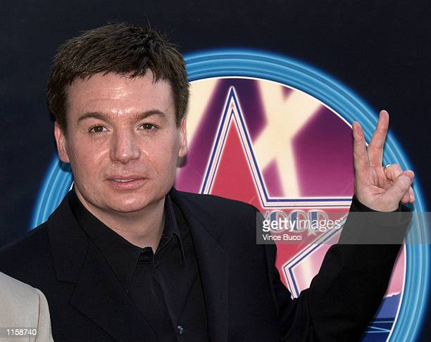 Actor Mike Myers attends a ceremony honoring him with a star on the Hollywood Walk of Fame on July 24 2002 in Hollywood California