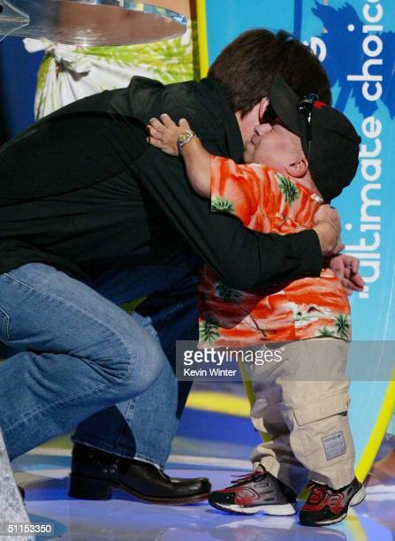 Actor Mike Myers hugs actor Verne Troyer on stage at The 2004 Teen Choice Awards held on August 8 2004 at Universal Amphitheater in Universal City...