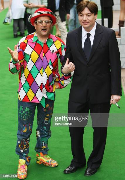 Actor Mike Myers jokes around with TV presenter Timmy Mallett as he arrives at the UK Premiere of 'Shrek The Third' at the Odeon Leicester Square on...