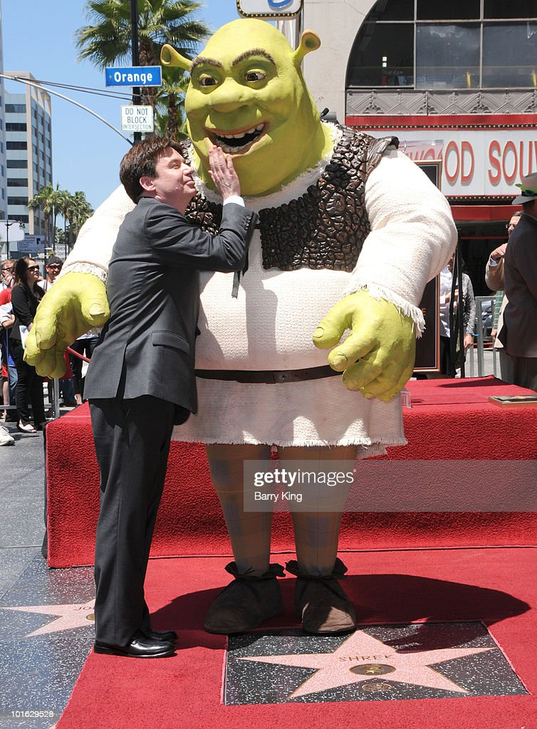 Actor Mike Myers poses with 'Shrek' at the Hollywood Walk Of Fame star ceremony honoring 'Shrek' held on May 20, 2010 in Hollywood, California.