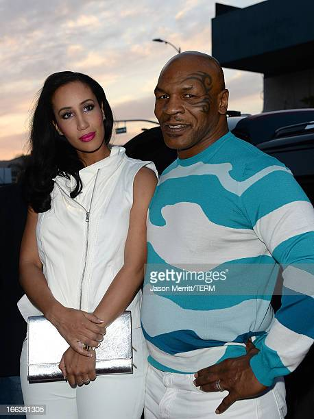 Actor Mike Tyson and Lakiha Spicer arrive at the Dimension Films' 'Scary Movie 5' premiere at the ArcLight Cinemas Cinerama Dome on April 11 2013 in...