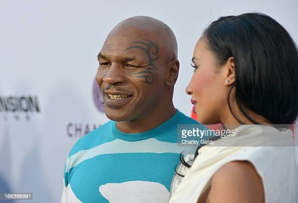 Actor Mike Tyson and Lakiha Spicer arrive at the premiere of Scary Movie V presented by Dimension Films in partnership with Lexus and Chambord at the...