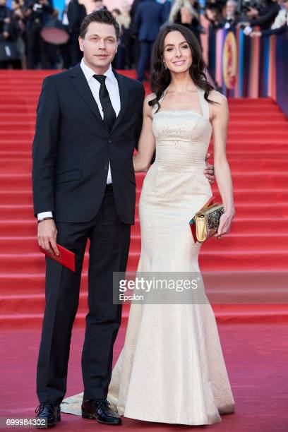 Actor Mikhail Dorozhkin with the companion attend opening of the 39th Moscow International Film Festival outside the Karo 11 Oktyabr Cinema on June...