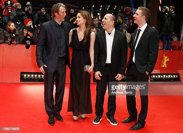 Actor Mikkel Boe Folsgaard director Nikolaj Arcel actress Alicia Vikander and actor Mads Mikkelsen attend the 'En Kongelig Affaere' Premiere during...