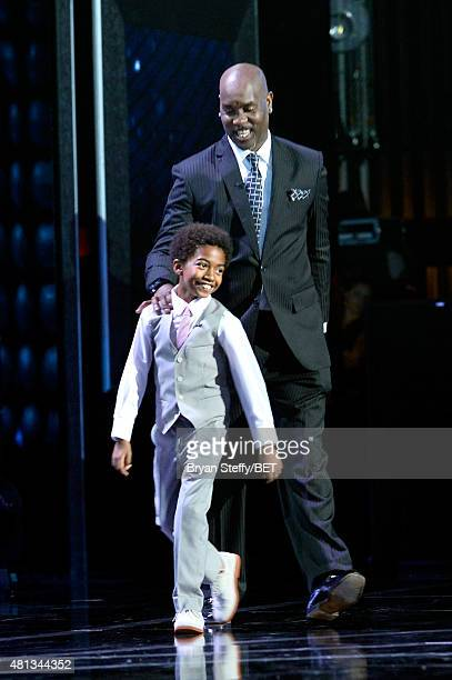 Actor Miles Brown and former NBA player Gary Payton walk onstage at The Players' Awards presented by BET at the Rio Hotel Casino on July 19 2015 in...
