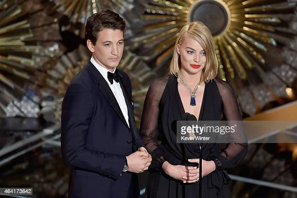 Actor Miles Teller and actress Margot Robbie speak onstage during the 87th Annual Academy Awards at Dolby Theatre on February 22 2015 in Hollywood...