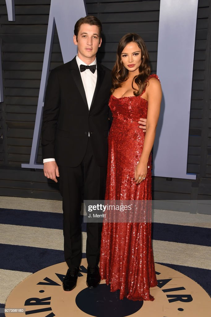 Actor Miles Teller (L) and Keleigh Sperry attend the 2018 Vanity Fair Oscar Party hosted by Radhika Jones at the Wallis Annenberg Center for the Performing Arts on March 4, 2018 in Beverly Hills, California.