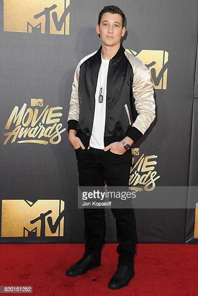 Actor Miles Teller arrives at the 2016 MTV Movie Awards at Warner Bros Studios on April 9 2016 in Burbank California