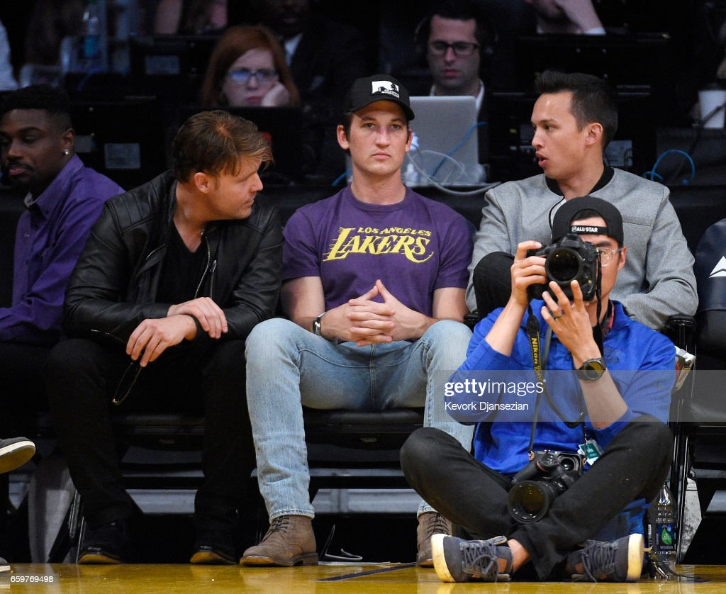 Actor Miles Teller (C) attends the Washington Wizards and Los Angeles Lakers basketball game at Staples Center March 28 2017, in Los Angeles, California.