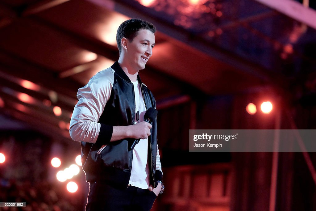 Actor Miles Teller speaks onstage during the 2016 MTV Movie Awards at Warner Bros. Studios on April 9, 2016 in Burbank, California. MTV Movie Awards airs April 10, 2016 at 8pm ET/PT.