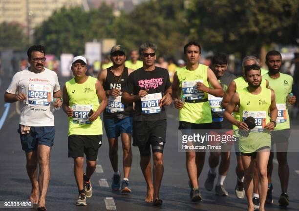 Actor Milind Soman run at Marine Drive during TATA Mumbai Marathon 2018 on January 21 2018 in Mumbai India