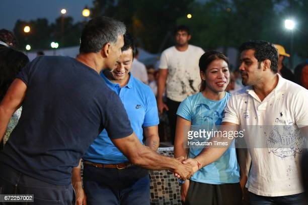 Actor Milind Soman with Wrestler Sushil Kumar and Boxer Mary Kom during the launch of Oorja by CAFP U19 Football Talent Tournament at India Gate on...