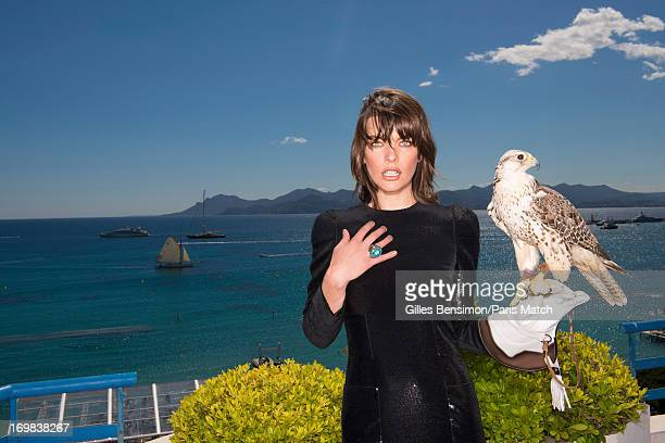 Actor Milla Jovovich wearing a Vuitton dress and ring by Swarovski is photographed for Paris Match on May 24 2013 in Cannes France