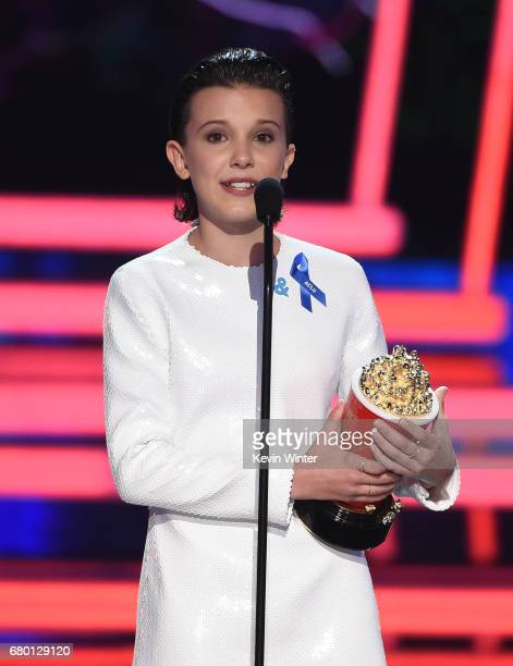 Actor Millie Bobby Brown accepts Best Actor in a Show for 'Stranger Things' onstage during the 2017 MTV Movie And TV Awards at The Shrine Auditorium...