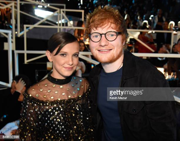 Actor Millie Bobby Brown and singer/songwriter Ed Sheeran attend the 2017 MTV Video Music Awards at The Forum on August 27 2017 in Inglewood...