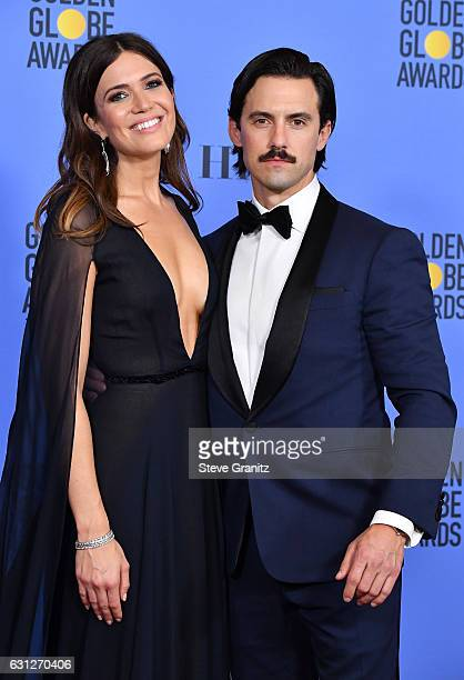 Actor Milo Ventimiglia and actress Mandy Moore pose in the press room during the 74th Annual Golden Globe Awards at The Beverly Hilton Hotel on...
