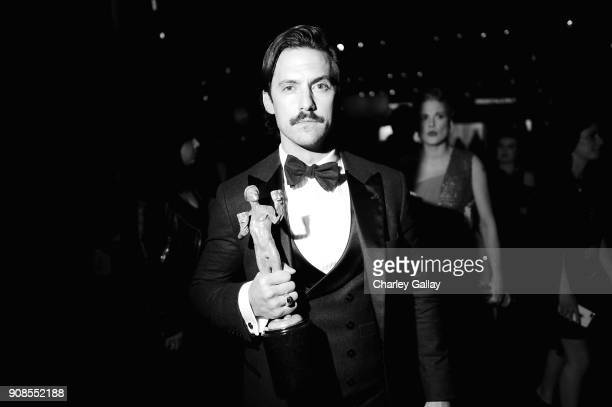 Actor Milo Ventimiglia poses with award for Outstanding Performance by an Ensemble in a Drama Series backstage during the 24th Annual Screen Actors...