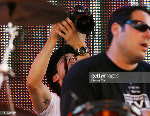 Actor Milo Ventimiglia takes pictures on stage at the 'Netflix Live On Location' concert series featuring 'The Band From TV' held at The Autry...