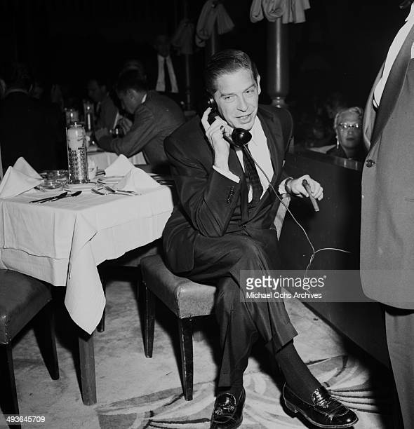 Actor Milton Berle attends the Moulin Rouge opening in Los Angeles, California.