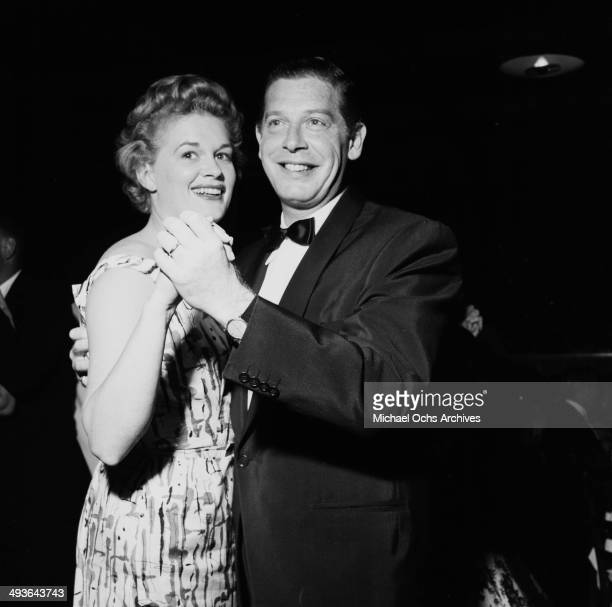 Actor Milton Berle dances with wife Ruth during a party in Los Angeles, California.