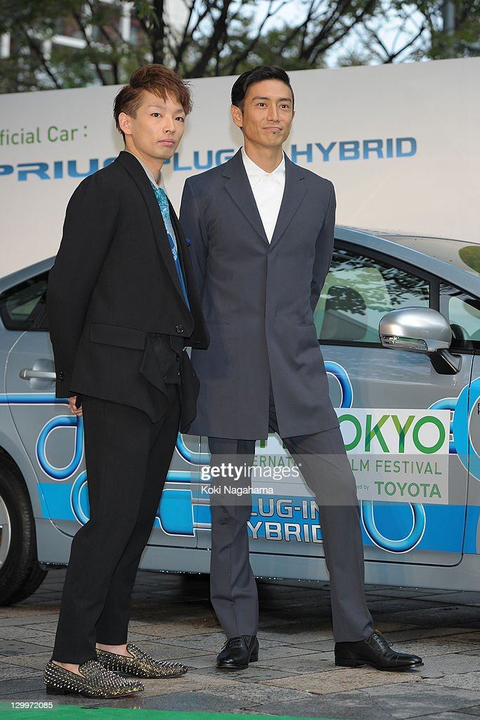 Actor Mirai Moriyama and Director Yusuke Iseya pose on the green carpet during the Tokyo International Film Festival Opening Ceremony at Roppongi Hills on October 22, 2011 in Tokyo, Japan.