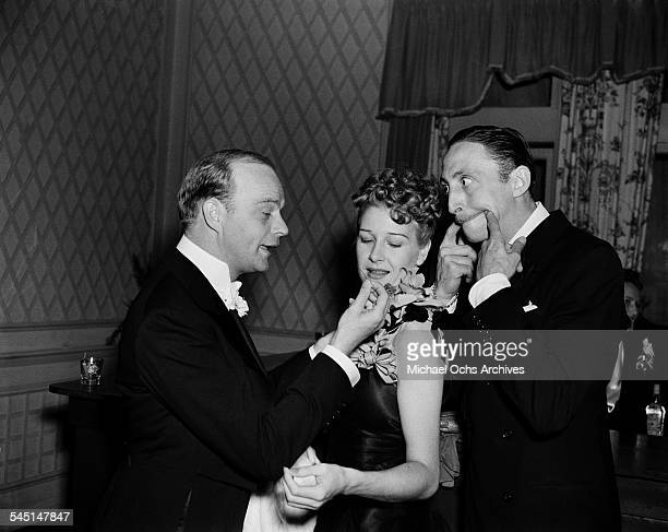 Actor Mischa Auer makes a face at ventriloquist Edgar Bergen during an event in Los Angeles California