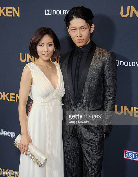 Actor Miyavi and Melody Ishihara arrive at the Los Angeles premiere of 'Unbroken' at The Dolby Theatre on December 15 2014 in Hollywood California