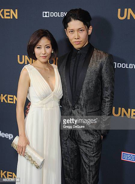 Actor Miyavi and Melody Ishihara arrive at the Los Angeles premiere of Unbroken at The Dolby Theatre on December 15 2014 in Hollywood California