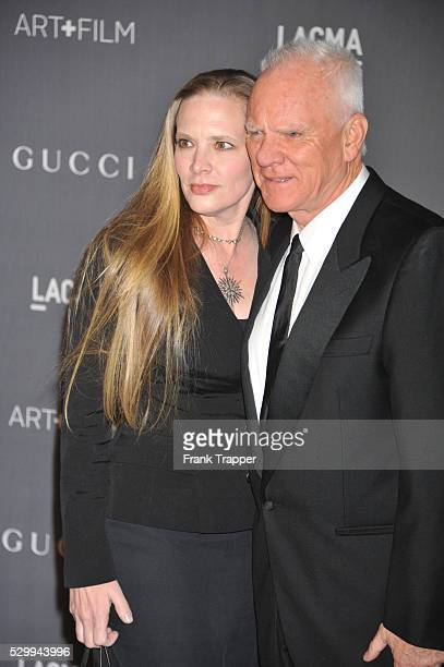 Actor Mlcolm McDowell and guest Kelley Kuhr arrive at LACMA 2012 Art + Film Gala held at LACMA.