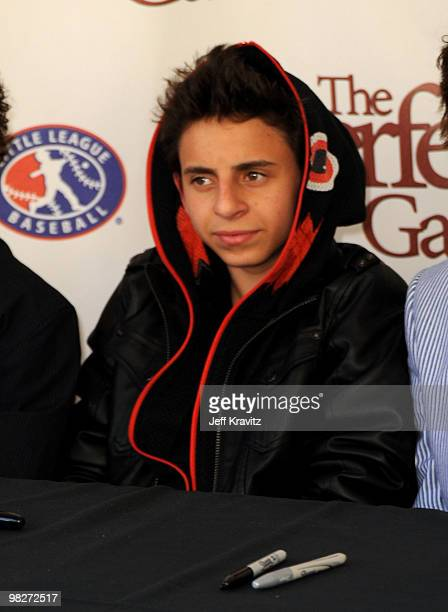 """Actor Moises Arias signs autographs during the Los Angeles premiere of """"The Perfect Game"""" pre-event in the Pacific Theaters at the Grove on April 5,..."""