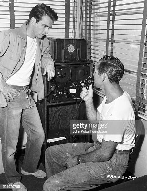 Actor Montgomery Clift talking to a man using a radio microphone for Columbia Pictures 1950