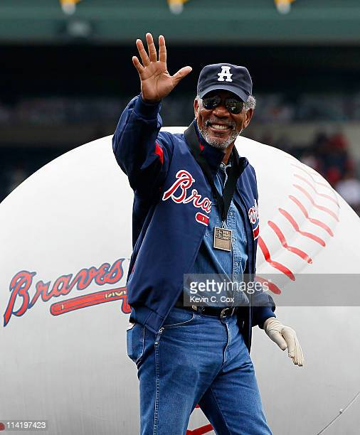 Actor Morgan Freeman acknowledges the crowd after receiving the MLB Beacon of Hope Award prior to the Civil Rights game between the Atlanta Braves...