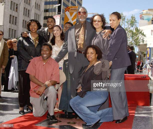 Actor Morgan Freeman and his family attend a ceremony honoring him with a star on the Hollywood Walk of Fame on March 18 2003 in Hollywood California